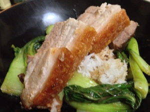 Crispy belly pork on rice with pak choi