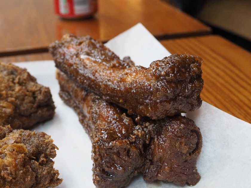 Pressure fried pork ribs in a sweet sticky sauce